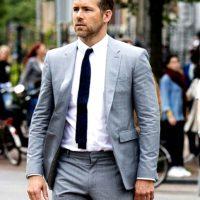 hitman bodyguard ryan reynolds grey suit