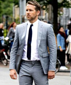 hitman bodyguard ryan reynolds grey suit